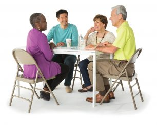 Four adults sit at the table