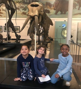 3 little girls are in history museum