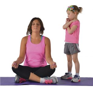 Woman in a yoga pose and a child standing