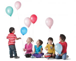 Children playing with balloons and a top