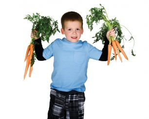 Boy holding carrots