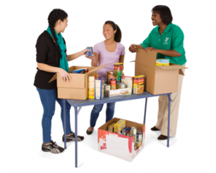 3 women unpacking boxes with food