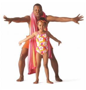 Man and girl in swimwear posing with their arms stretched out