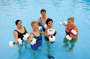 women-in-the pool-holding-weights